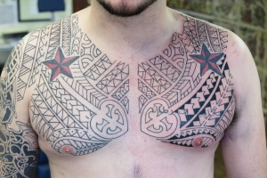 polynesian inspired chest tattoo